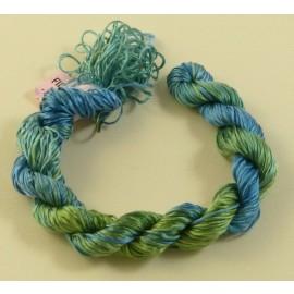 Filaments de soie du vert au bleu