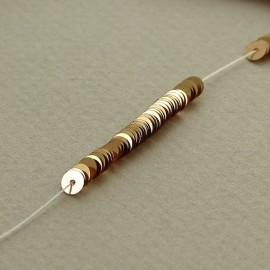 Paillette 4 mm or cuivré brillant sur fil