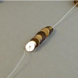 Paillette 6 mm or cuivré brillant sur fil