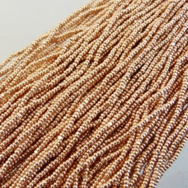 Strung Charlotte 13/0 metallic salmon gold