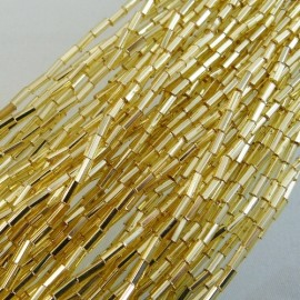 Bugle beads 4 mm facetted light gold on strand