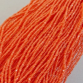 Strung Charlotte 13/0 opaque orange lustered