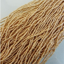 Seed bead 2 mm metallic gold on strand